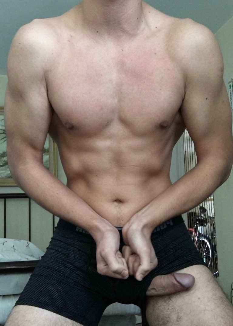 Flexing boy with his cock out