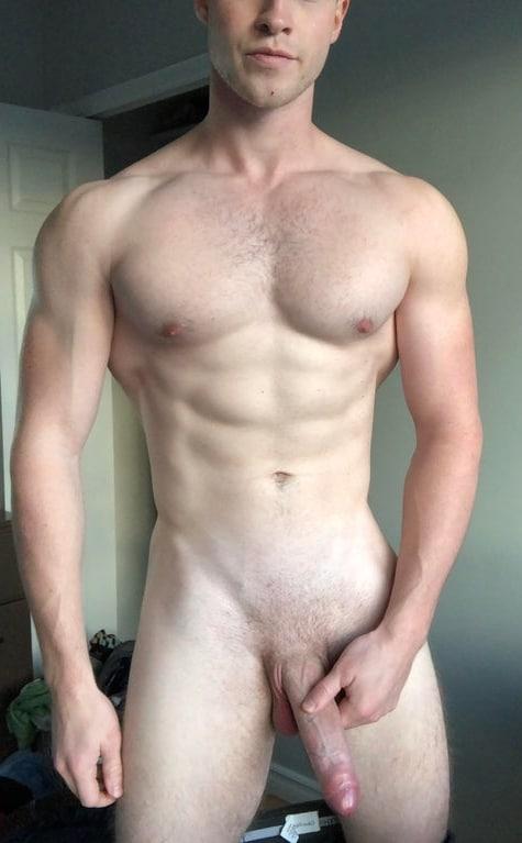 Hunk holding his hard cock