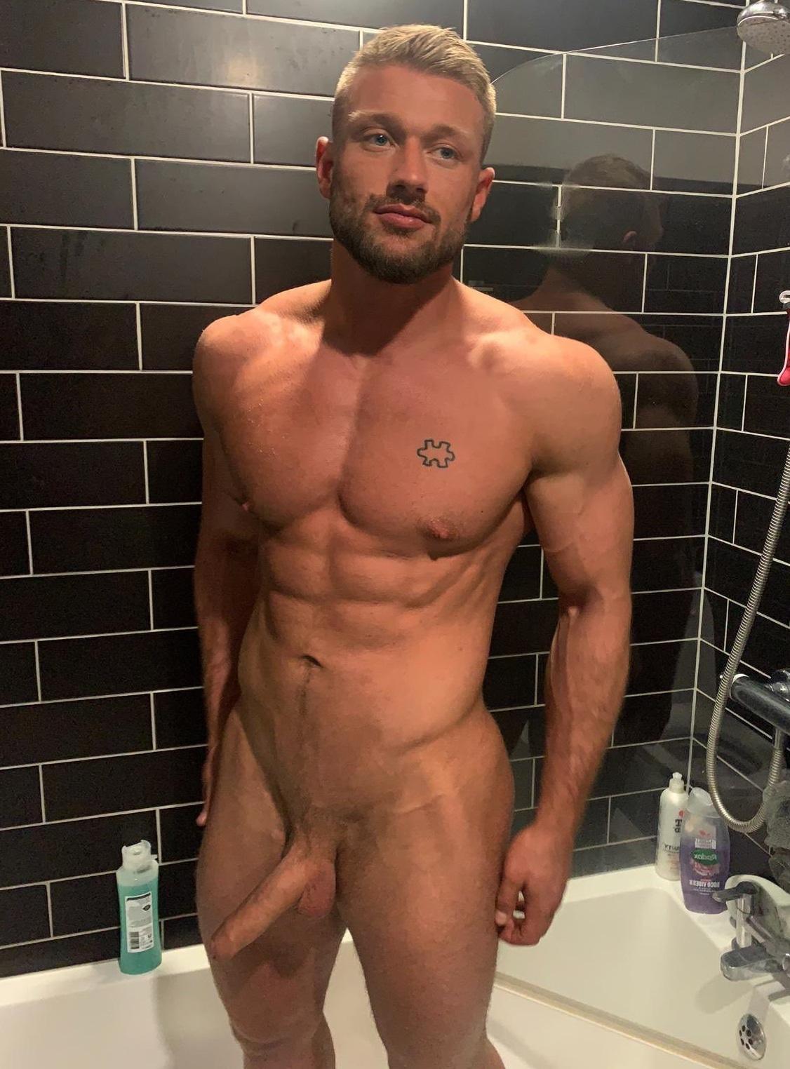 Hunk taking a nude selfie