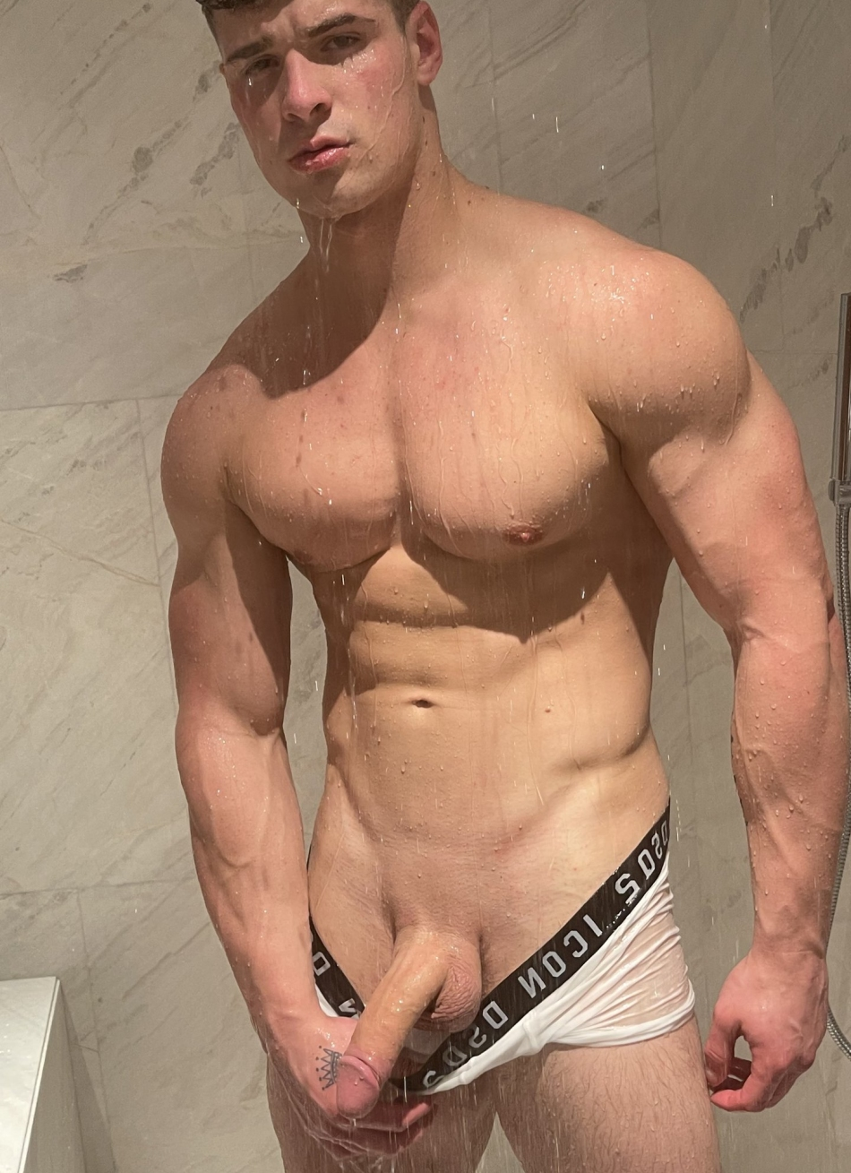 Muscle boy in the shower