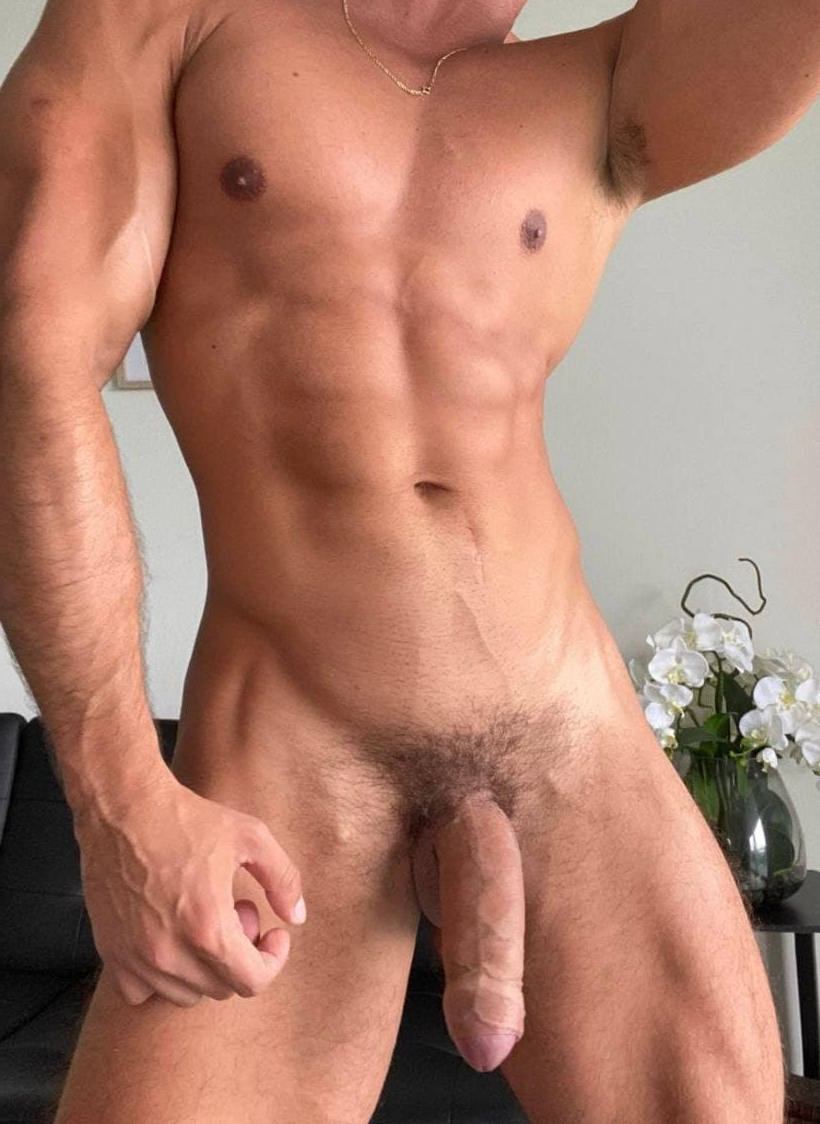 Tanned hunk with a big cock